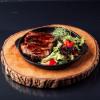 Свинной стейк с салатом Grill Pub Bitok