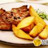 Стейк из ошейка свинины с печеным картофелем и соусом BBQ Sorrento